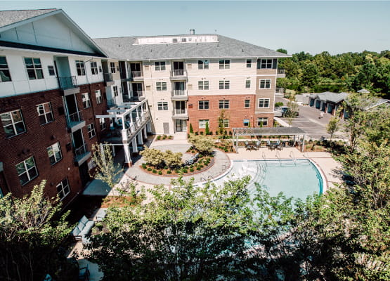 aerial view of pool with trees in foreground at avenida watermarq germantown