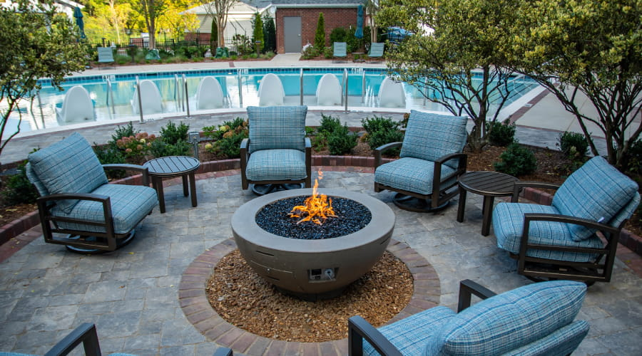 firepit with seating and pool in background avenida watermarq germantown