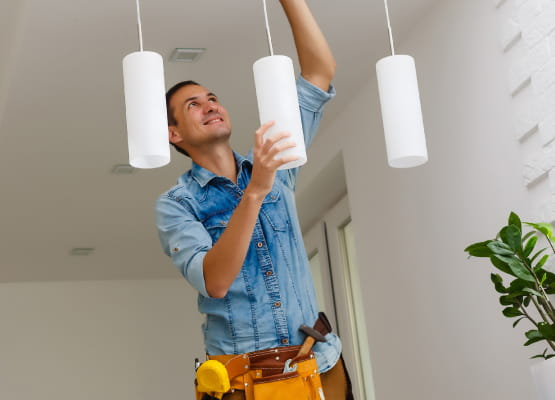 handyman installing lights
