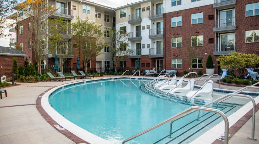 pool with residences in background at avenida watermarq germantown