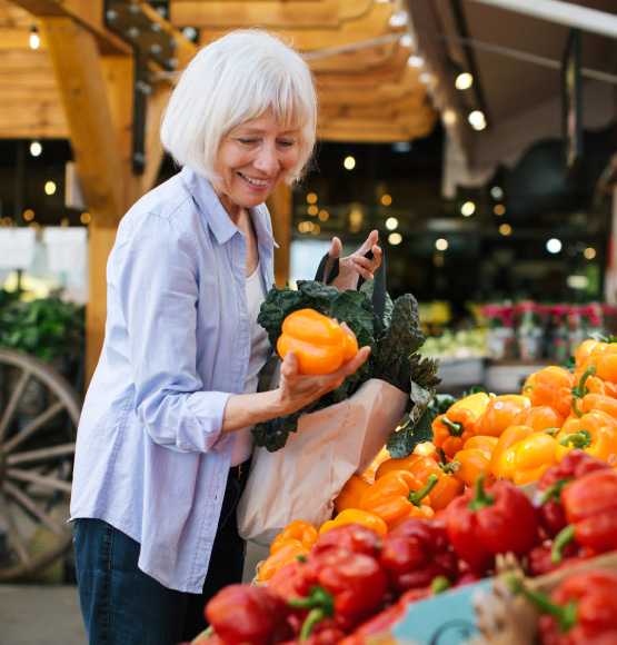 woman shopping for bell peppers